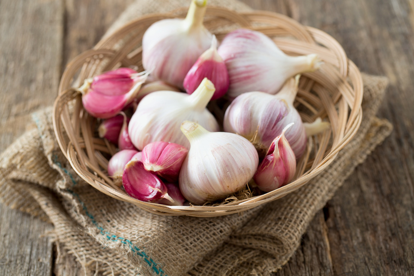 fresh garlic on wooden surface
